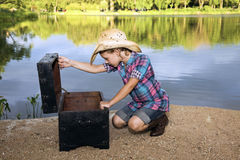 What's there?. Little girl by the lake stock image