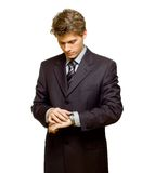 What's the time. ? Businessman looking at his watch Stock Photography