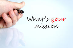 What's your mission concept. Pen in the hand  over white background What's your mission concept Royalty Free Stock Image