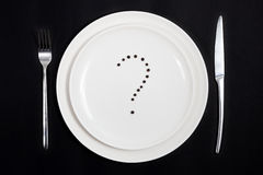 What shall we have today for dinner?. Concept of the difficulty of planning a daily menu Stock Image