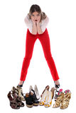 What shoes to wear?. Woman can´t decide what pair of shoes to wear Royalty Free Stock Images