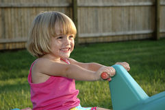 What a Smile. Photo of Young Girl Playing and Having Fun Royalty Free Stock Image