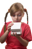 What a surprise!. Wondering funny little girl with opened present box isolated over white background Royalty Free Stock Images