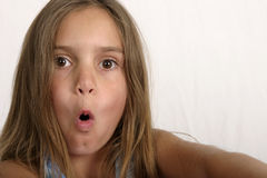 What a surprise. Young girl with surprised look on face Royalty Free Stock Images