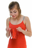 What is there. Young woman in red with red gift on white Stock Photo