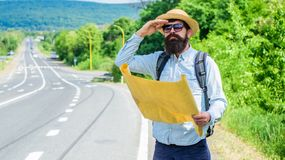 What is there. Tourist with map see familiar landmark. Seems finally got destination point. Tourist try to recognize. Familiar place using map. Backpacker man royalty free stock images
