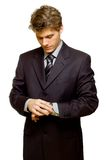 What is the time. What's the time? Stressed businessman looking at his watch stock photography