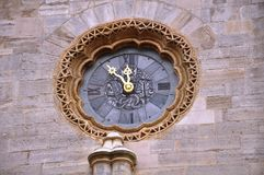 What time it is. Interesting architecture on a church in Viena Stock Photography