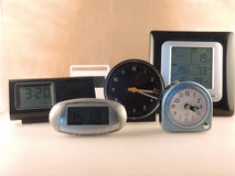 What time is it?. Some table-clocks of different shape and size Stock Photography