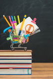 What to buy for Back to school supplies in shopping cart Royalty Free Stock Images