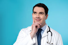What to do next ?. Male physician thinking about something Stock Images
