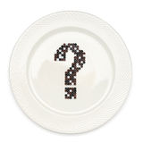 What to eat?. Question mark on the white plate Stock Photography