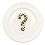 What to eat?. Question mark on the white plate Royalty Free Stock Images