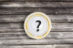 What to eat?. Gray old plank table and Blank plate with question mark Royalty Free Stock Photos