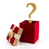 What to give for a present. A red velvet present with a gold bow and gold question mark on white, What to give for a present Stock Images