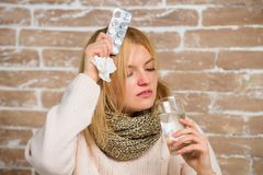 What to know about breaking fever. Girl suffer fever and take medicine. Headache and fever remedies. Take medications to. Reduce fever. Woman tousled hair scarf royalty free stock image