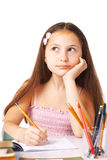What to Write?. Cute little girl sketching something, holding her hand under her chin, looking away Royalty Free Stock Image