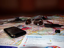 What the tourist must take in the road?. Tourists require little in the way: Map, sunglasses, phone, credit card, music Stock Photo
