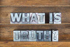 What is truth tray. What is truth question made from metallic letterpress type on wooden tray royalty free stock images
