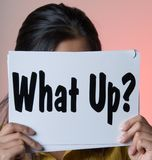 What up - Sign Series. Female holding up a What up? Sign Royalty Free Stock Images