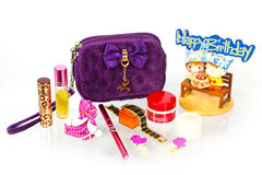 What is in the woman's bag. Perfume, cosmetics, watch, bandanna Stock Photos