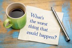 What is the worst thing that could happen?. Worst case scenario - handwriting on a napkin with a cup of espresso coffee royalty free stock photo
