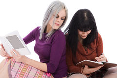 What is she writing?. Sisters working on their home works Royalty Free Stock Photo