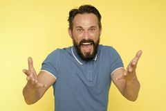 What are you doing. Stop annoying him. Overwhelmed with emotions. Handsome shouting mature man screaming standing. Against yellow background. Man bearded royalty free stock image