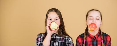 What are you eating today. Little girls eating apples. Small children choosing healthy eating. Developing healthy eating stock photography