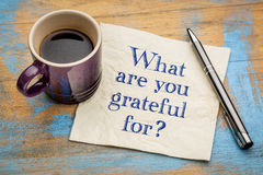 What are you grateful for?. A question on a napkin with a cup of espresso coffee Stock Images