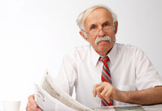 What You Are Saying?. Portrait of an elder man holding an newspaper and looking at you Stock Images