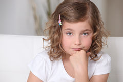 What are you staring at?. Grumpy little girl is in a foul mood Stock Images