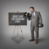 What are you waiting for text on blackboard with businessman Royalty Free Stock Images