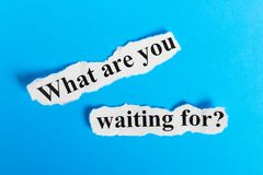 What are you waiting for text on paper. Words what are you waiting for on a piece of paper. Concept Image.  Stock Images