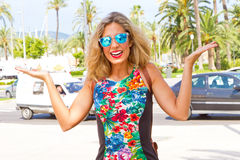 What ?. Young, blond woman with sunglasses stock photos