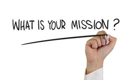 What is Your Mission ?. Business concept image of a hand holding marker and write What is Your Mission isolated on white Stock Photo