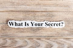 What Is Your Secret text on paper. Word What Is Your Secret on torn paper. Concept Image Royalty Free Stock Photography