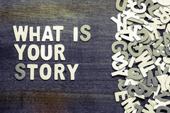 What Is Your Story. Text with scattered wood letters Stock Image