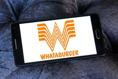 Whataburger restaurant chain logo. Logo of Whataburger restaurant chain on samsung mobile. Whataburger is an American privately held regional fast food stock image