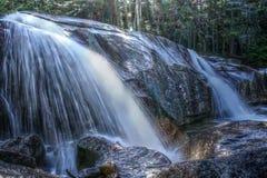 Whaterfall i den vita bergnationalparken, New Hampshire, USA Arkivfoton