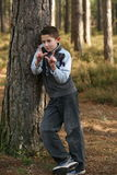 Whatever!. A young teenage boy leaning against a tree with attitude Royalty Free Stock Photos