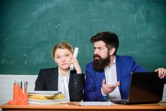Whatever concept. School staff. School collective and colleagues relations. Teacher and supervisor working in school. Classroom. School educator indifferent royalty free stock photo