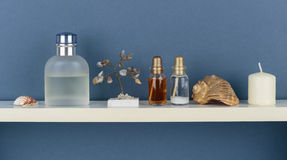 Whatnot and sundries on white shelf. On blue wallpaper background Stock Images