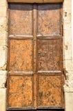 Whats behind the door. And old door in Greece Stock Photos
