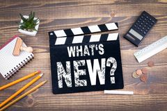 Free Whats New. Movie Clapper On A Wooden Desk Royalty Free Stock Image - 110879156