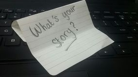 Whats your story note. Handwritten what's your story note on a computer keyboard Stock Image