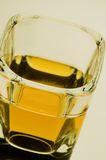 Whats your tipple. A closer shot of whiskey in a shot glass, would make a nice winter wamrig card Royalty Free Stock Photography
