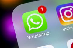 Whatsapp messenger application icon on Apple iPhone X smartphone screen close-up. Whatsapp messenger app icon. Social media icon. Sankt-Petersburg, Russia Stock Photography