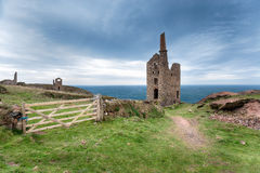Wheal Owles on the Cornish Coast. The ruins of Wheal Owles and old engine house from copper mining on cliffs at Botallack on the Cornish coast, also used in TV Royalty Free Stock Photo