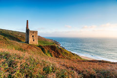 Wheal Prosper Cornish Engine House. The Wheal Prosper engine house perched on cliffs at Rinsey Head near Porthleven in Cornwall royalty free stock photos